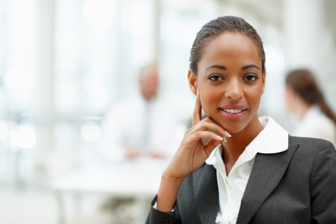 african-female-CA-sits-desk